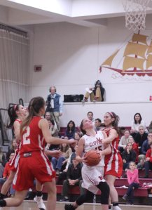 Krysta Padellar (11 points) in the lane