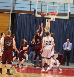 Josh Smestad (#2) converts a rebound with 24 seconds left