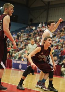 Josh Smestad (22 points) guards Mike Norton (27 points) on an inbounds play