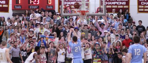 Triton's Jack McCarthy shoots a free throw facing the active Newburyport student section