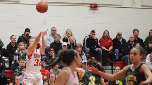 Abbie Sartori (17 points) fires from the corner